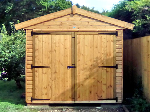 Sectional timber buildings quality timber storage sheds for Tops garden buildings